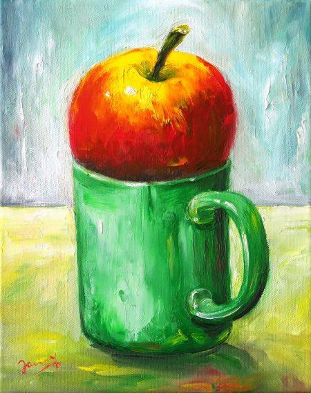 Apfel auf grüner Tasse